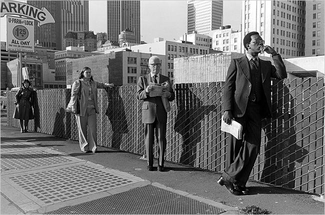People waiting for a bus. B/w photo by Hank Wessel