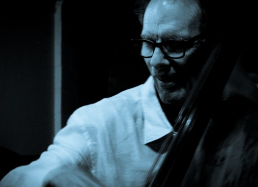 a black and white photo of bassist glen moore