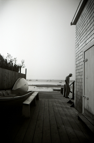 b/w photo of a man on a dock in provincetown